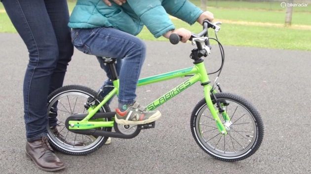 teach an older child to ride a bike